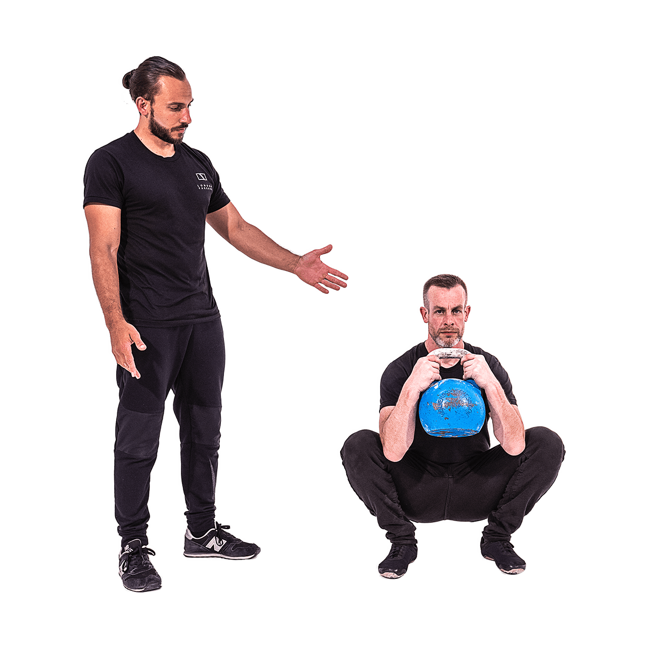Kevin teaches Andy a kettlebell squat.